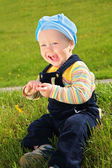 Child with dandelion on meadow — Stock Photo