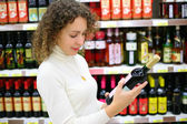 Young woman in wine shop — Stock Photo