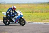 Racer on motion — Stock Photo