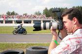 Photographer on motorcycle race — Stock Photo