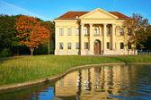 Mansion at reservoir — Stock Photo