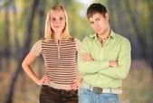 Couple on autumnal background — Stock Photo