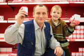 Grandfather and grandson in food shop — Stock Photo