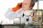 Man speaks on phone behind table with different equipment — Stock Photo