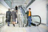 On ladder and escalator — Stock Photo
