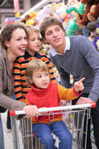 Parents with children in shop — Стоковое фото