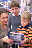 Boy with parents with toy in shop — Stock Photo