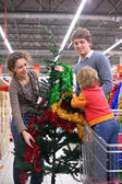 Family buys Christmas-tree with decorations — Stok fotoğraf