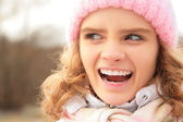 Portrait of angry young girl outdoor in winter — Stock Photo