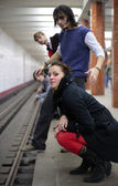 Group of young friends on edge of platform of subway station — Foto Stock