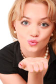 Blonde blows on palm — Stock Photo
