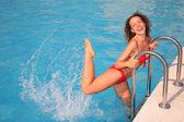 Young woman splashing in basin — Stock Photo