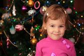 Christmas fir and little girl — Stock Photo