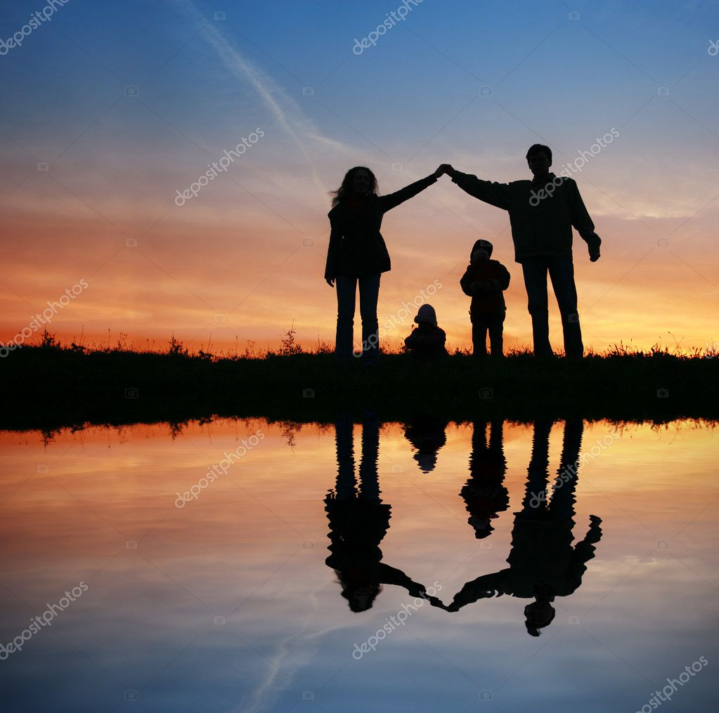Silhouette family house on sunset water — Stock Photo #7440109