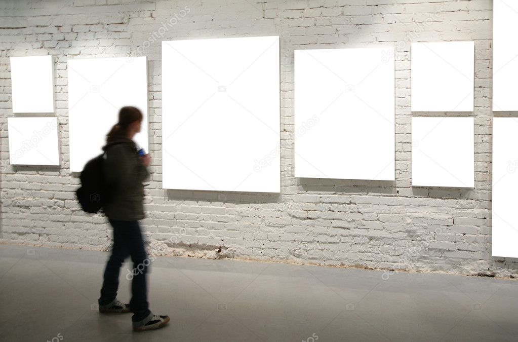 Girl walk through frames on a brick wall — Stock Photo #7443022