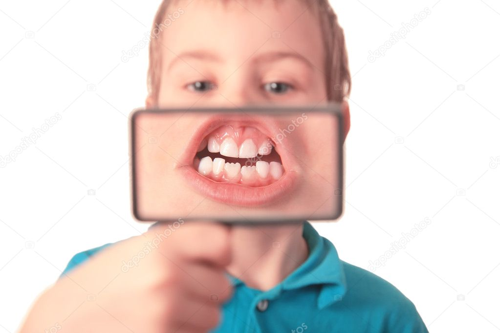 Boy shows  teeth through  magnifier — Stock Photo #7444971