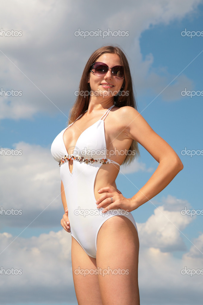 Girl in bathing suit and sunglasses against sky — Stock Photo #7445811