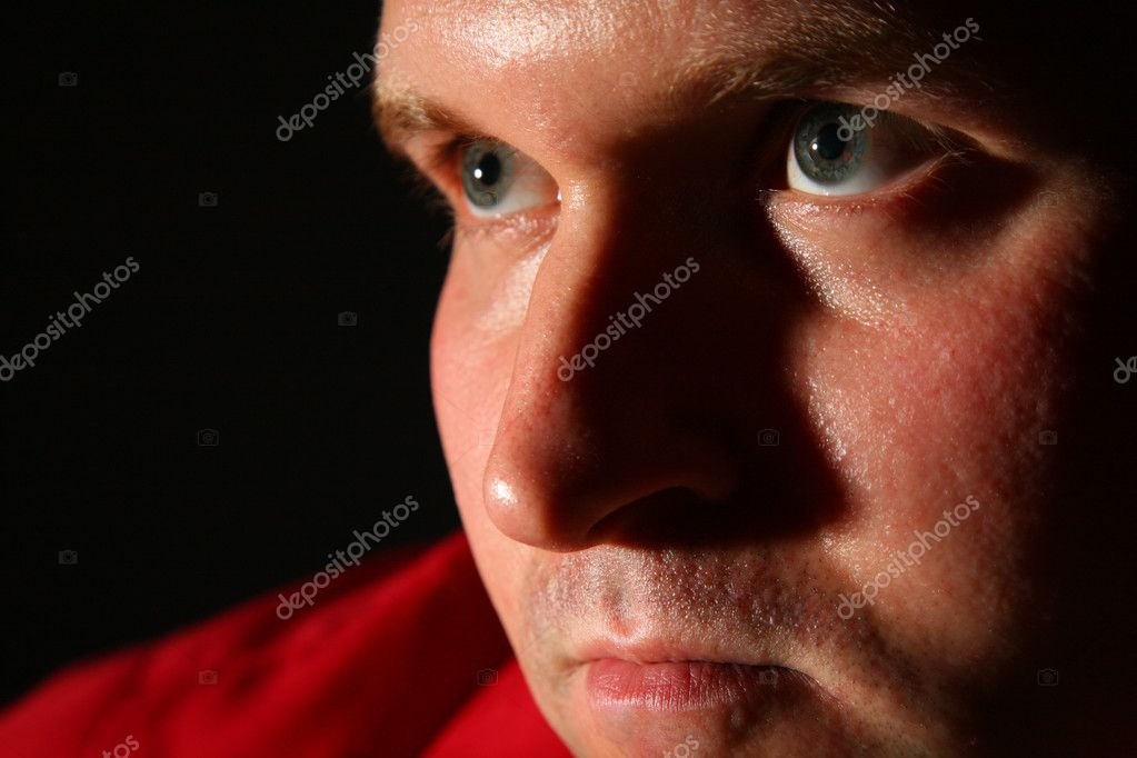 Thinking man in red shirt in dark — Stock Photo #7446579