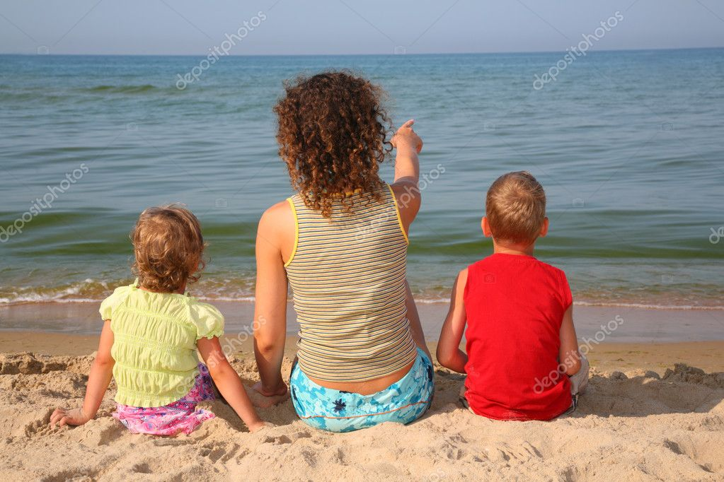 Behind mother with children on beach  Stock Photo #7446869