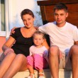 Family sits on steps — Stock Photo
