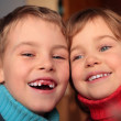Laughing boy without foreteeth and smiling girl — Stock Photo #7450165