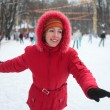 Young woman on skating rink in park — Stock Photo