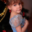 Little girl at christmas tree — Stock fotografie