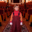 Little girl in theatrical hall — Foto de Stock