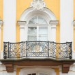 Baroque balcony on  facade of house - Stock Photo
