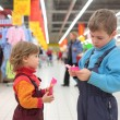 Children in supermarket - Stock Photo