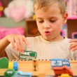 Stock Photo: Boy plays in playroom