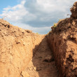 Trench in earth - Stock Photo