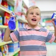 Royalty-Free Stock Photo: Boy in household chemical goods department in shop