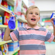 Boy in household chemical goods department in shop — Stock Photo