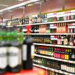 Shelves with wines in shop — Stock Photo