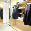 Clothes on racks in shop — Zdjęcie stockowe #7450574