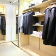 Clothes on racks in shop — Foto Stock #7450574