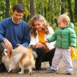 Family in autumn park — Stock Photo #7450647