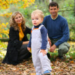 Family in autumn park — Stock Photo #7450703