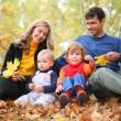Family in autumn park — Stock Photo