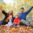Family in autumn park — Stok fotoğraf #7450742