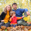 Family in autumn park — Stok fotoğraf #7450745
