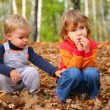 Family in autumn park — Stock Photo #7450749
