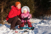 Mother and daughter with snow scooter — Stockfoto