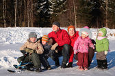 Family in wood in winter — Stock Photo