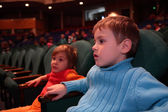 Boy and girl in theater — Stock Photo