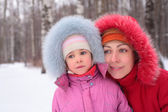 Mother with child in wood in winter — Stock Photo