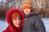Mother with son in wood in winter — Stock Photo