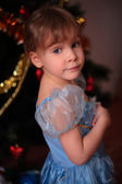 Little girl at christmas tree — Stock Photo