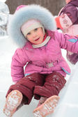 Girl rolls down on ice slope — Stock Photo